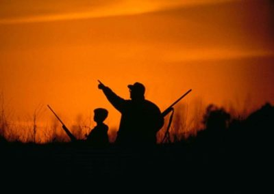 silhouette-of-father-and-son-hunting-in-the-sunset-725x474